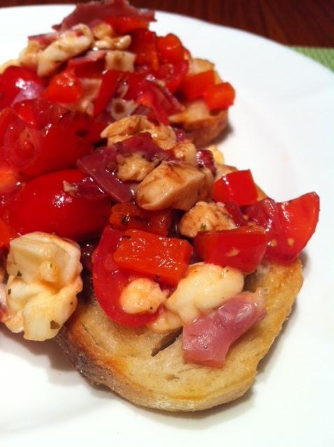 Cherry tomato, grilled red pepper, buffalo mozzarella and chopped salami Bruschetta via Adored By Alex