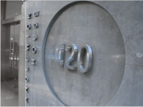 Brushed stainless steel  architectural letters with returns.  Fixed to external concrete pillar  via rear locator fixings.