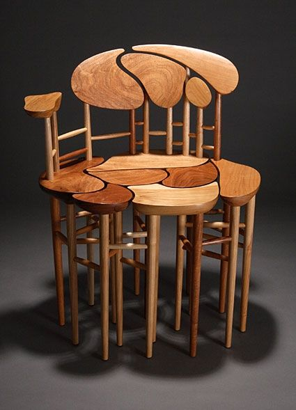 Chair made from mesquite and ash. Size is 23 inches wide, 17 inches deep, 30 inches tall.  By Danny Kamerath.