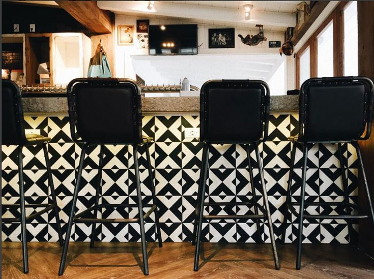 Granada Tile's Serengeti Cement Tiles decorate the front of the bar at Hermosa Beach's Tower 12