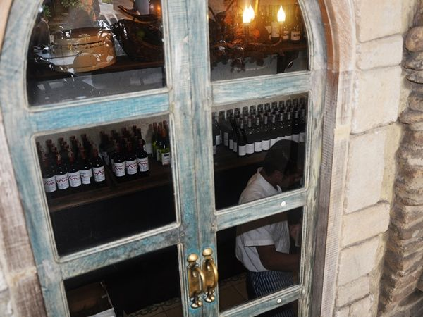 Wine cellar at Kebun Bistro, Ubud, Bali: cosy French bistro