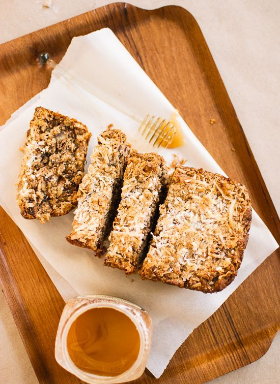 Hearty banana bread made with coconut, oats and whole wheat flour and naturally sweetened with honey.
