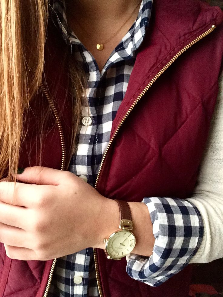 Add a pop of burgundy to your preppy layers this fall with a quilted vest.