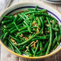 Green Beans with Garlic and Almonds - Jess made these for Thanksgiving, delicious way to serve green beans. Half the olive oil.
