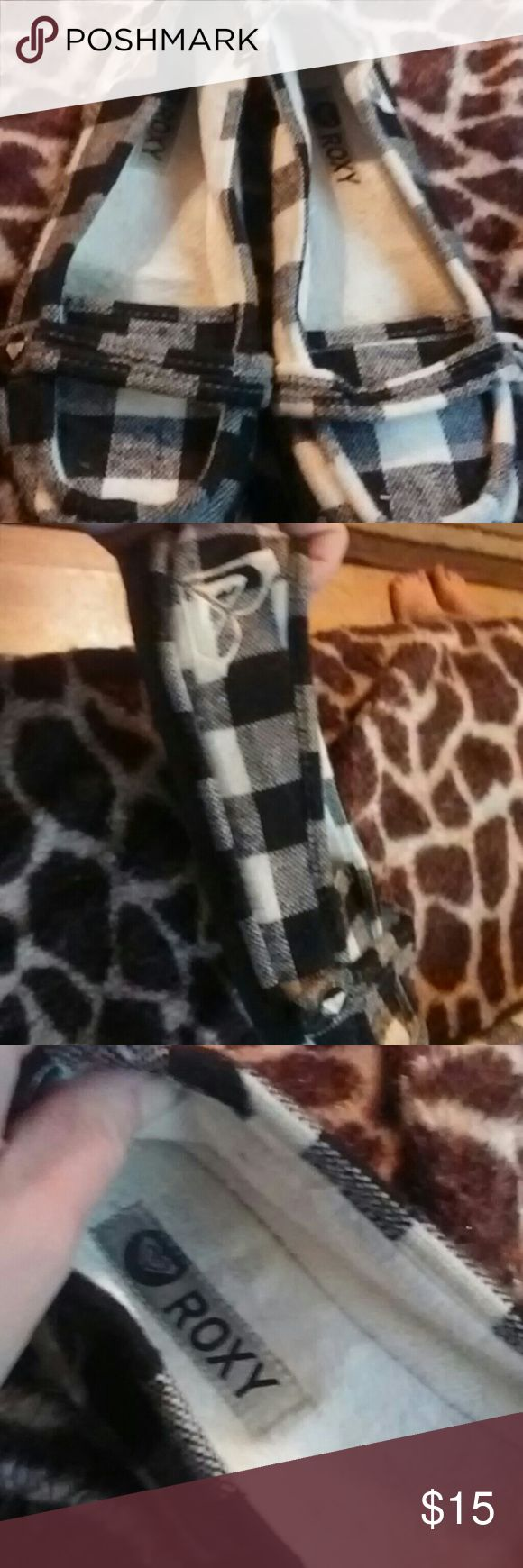 Roxy slippers Black and white checkered slippers. Good used condition no stains or tears. Soft almost fleece inside. Roxy Shoes Slippers