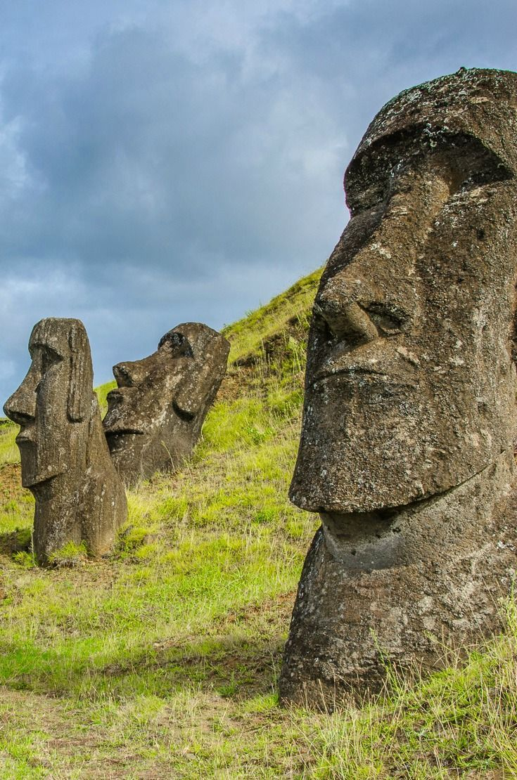 """Easter Island is one of the most remote, inhabited islands in the world, located in the middle of the Pacific Ocean, more than 2,000 miles off the coast of South America. The island is famous for it these giant stone heads (called """"moai""""), carved by the indigenous Rapa Nui people more than 500 years ago."""