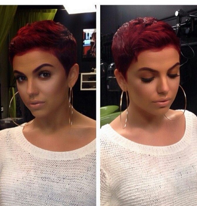 I'm putting this one in style because I like it all.. the cut, the color, and the make up. She's rockin it.
