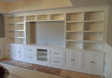 built in design for the living room. book shelves and a counter......or bedroom....I see tv space, shoe/bag shelves sweater/ jean organization .... And then some!