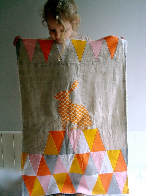That's the Point Stroller Quilt - orange triangles from Tree Fall Design