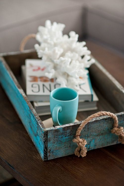 Cute beach nautical vignette on a tray.