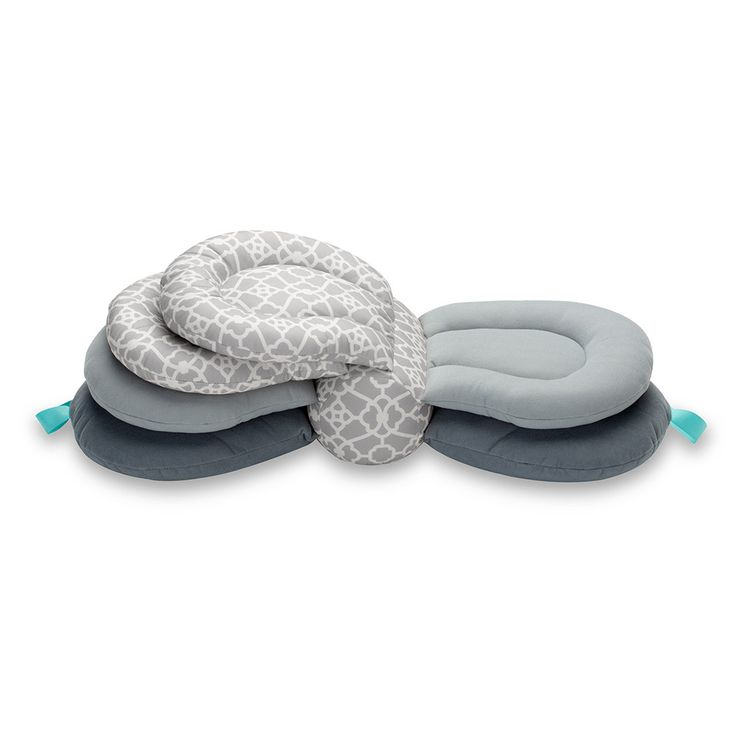 Get the perfect latch with a flexible nursing pillow that elevates your baby to breast height; supporting successful nursing in whatever hold feels right to you