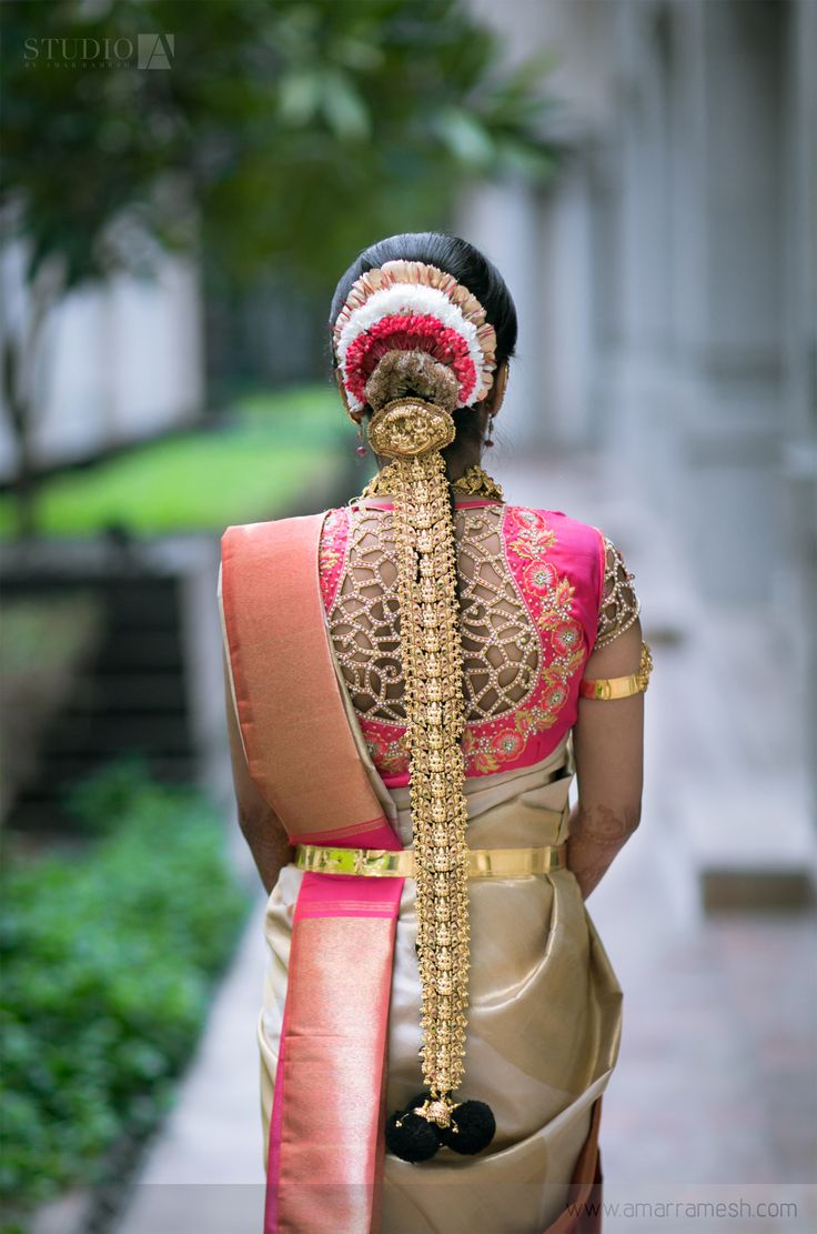 South Indian bride. Gold Indian bridal jewelry.Temple jewelry. Jhumkis.silk kanchipuram sari with contrast pink cutwork blouse.braid with fresh jasmine flowers. Tamil bride. Telugu bride. Kannada bride. Hindu bride. Malayalee bride.Kerala bride.South Indian wedding.