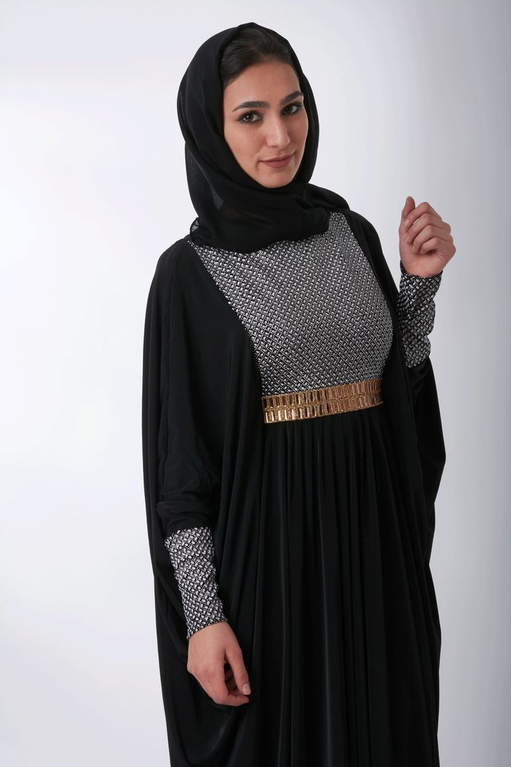 Starlet Abaya: Gorgeous black abaya with shimmery chest and gold belt. Stretch-polyester material drapes beautifully, and butterfly-style design delivers a modest and non-clingy abaya. Inside tie lets you choose your own fit. Matching detail on abaya chest, cuffs, and hijab. #abayafashion #abayasonline #eid