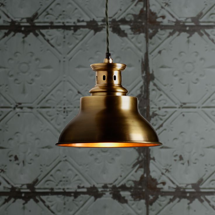 Antiqued brass pendant in a happy combination of straight lines and round lines. Casts a gentle and warm glow