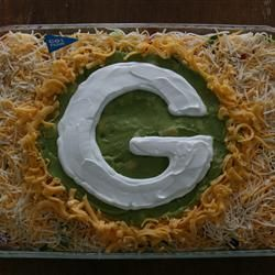 Seven Layer Dip.....I make this recipe but the finish on this one is awesome!  Go GBP