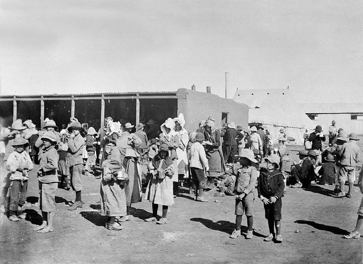 Boer women and children in a British concentration camp during the Boer war circa 1901. Total War - Photograph of Boer civilians in a British concentration camp. National Army Museum