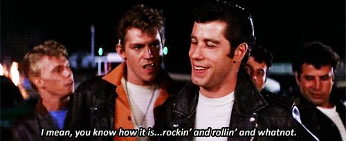 """Kelly Ward as Roger """"Putzie"""", Jeff Conaway as Kenickie, John Travolta as Danny Zuko, Barry Pearl as Doody, and Michael Tucci as Sonny LaTierri in Grease, 1978"""