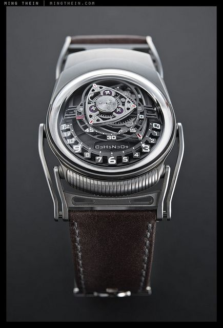 C3H5N3O9 Experiment ZR012 ~ brainchild of Max Büsser (MB) and Felix Baumgartner (URWERK), it is the first watch to use an eccentric planetary transmission system for the timekeeping mechanism - i.e. the same geometry as the Wankel engine.