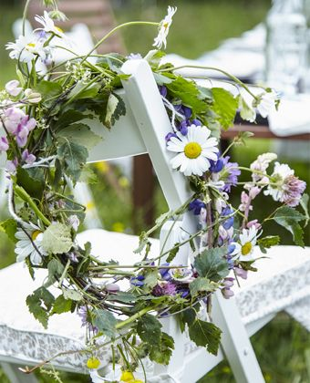 Weave wildflowers together to create traditional midsummer crowns for your guests