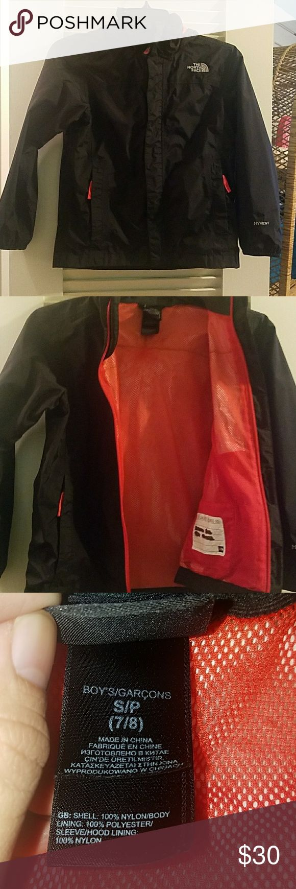 The North Face Resolve jacket boys Small TNF resolve rain jacket retails $69.95 size small boys 7/8 on black and red.  Name covered with a permanent marker inside.  Great condition! The North Face Jackets & Coats Raincoats