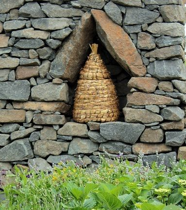 bee skep.  Gorgeous. Also note there is No opening on the side. The old bee hives allowed for entry from the bottom underneath. Side openings are possible entries for predators.  Bees know to go under the skep for entry.