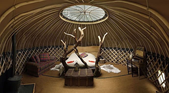 Handcrafted chestnut yurt built by Guy Mallinson near West Dorset, UK. Crafty Camping - luxury  'glamping' in an adults-only, hand-crafted environment as well as wood-working workshops. Stay in cosy bell tents and beautiful yurts, tipi and shepherds hut. enjoy the wonderful 'glamping' facilities, which include woodland showers, a sauna yurt and a communal yurt with games and craft library, while the 'Out of Africa' kitchen and pizza oven further help ensure a restful holiday with a…