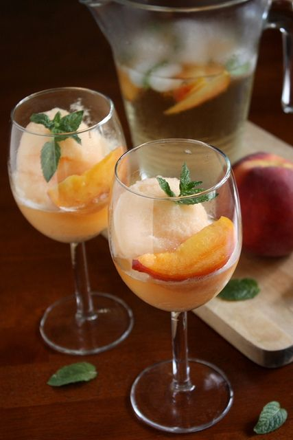 Peach Sangria Sorbet--white wine, peach schnapps, fresh peaches....great summer drink:)