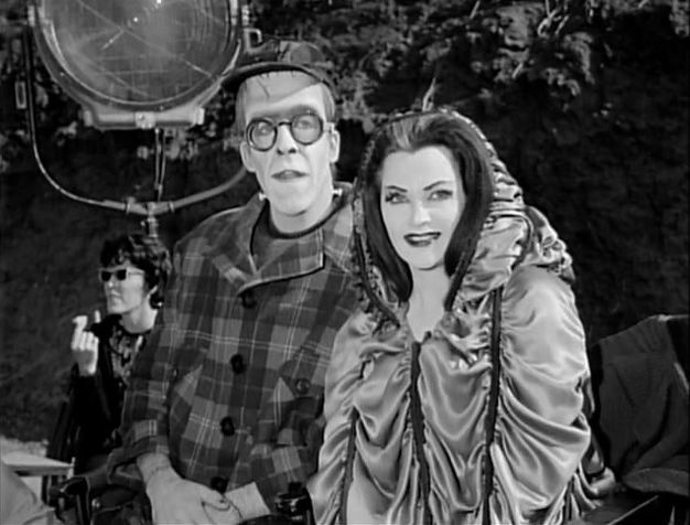 Fred Gwynne and Yvonne De Carlo behind the scenes during filming of The Munsters.