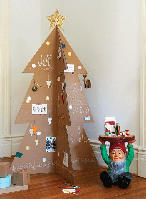 Make a modern Christmas tree that serves as a holiday guest book! #cardboardtree #diy #holidaydecorating #christmas #crafts