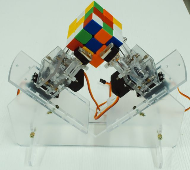 This product is a cube solver robot with Arduino. At present,there are 3 actions including 90 degrees clockwise rotation, 90° anticlockwise rotation and 180 degrees rotation. The robot executes the corresponding action depending on the Rubik's cube reduction formula to solve the cube.The type of cube which the Robot can solve is Standard third-order cube(Flexible rotating cube will be more better) The size of cube: International standard Rubik's Cube (57*57*57mm)