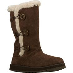 Snuggle up in style and comfort with the SKECHERS Keepsakes - Canoodle boot. Soft suede upper in a slip on casual mid calf height cool weather boot with stitching and overlay accents. Faux fur trim.Soft faux for collar lining. Soft fabric boot lining. Cushioned insole. Shock absorbing midsole. Flexi