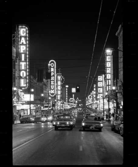 Granville Street neon at night  VPL Accession Number: 43347  Date: 1965  Photographer / Studio: Province Newspaper  Content: Theater Row