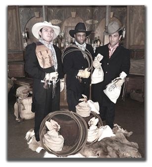 """""""The Bank Robbers"""" Old Time Photo Booth for rent in Little Rock AR complete with Saloon Backdrop, Costumes, Money Bags, Old Time Money, Cowboy Ropes, Vintage Gold Dust Bags, Accessories, Saddle Bags, & Guns with complete mobile service to the entire USA."""
