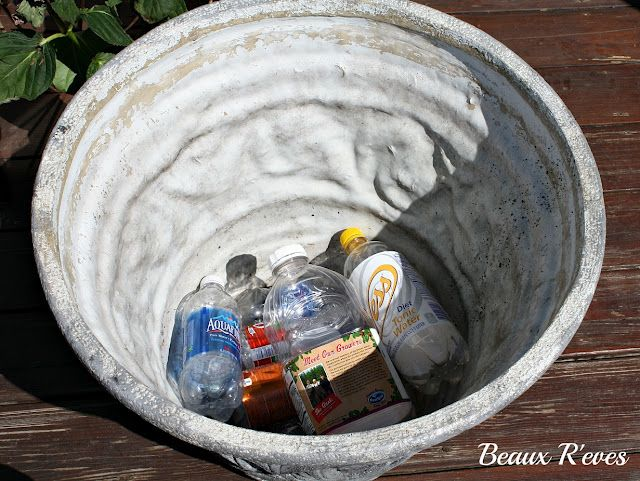 Use plastic bottles for drainage in large plant pots