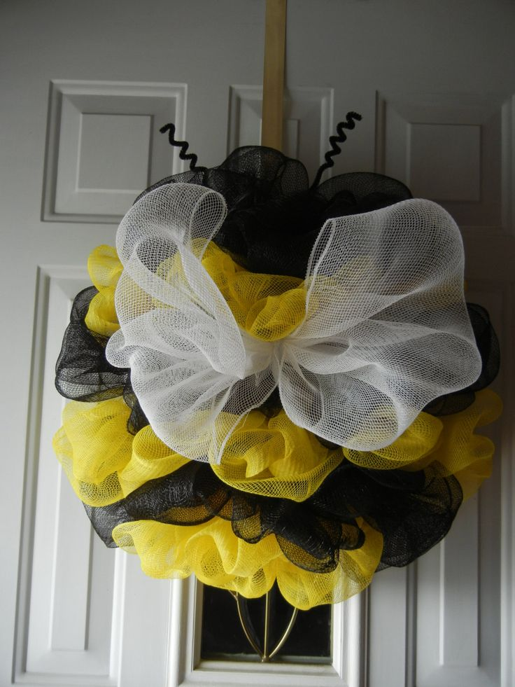 Bumble Bee Deco Mesh Wreath  This Adorable Bumble Bee Wreath is made on a 12 inch wire wreath form and is approximately 18 x 18.  It is made with Black and Yellow Deco Mesh and I used White Deco Mesh for the wings along with 2 black pipe cleaners for the antennas.  Perfect for Spring and Summer  This item will be shipped within 3 to 5 business days after receiving payment.  Item will be made after purchase and may vary slightly from picture. I will send a picture before shipment. Thank You