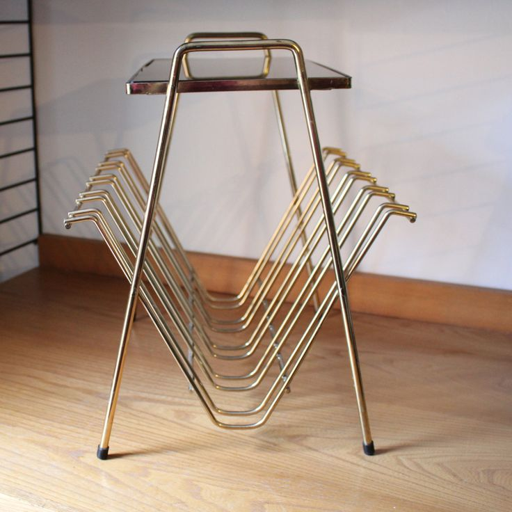 A stylish magazine rack side table, smokey glass top, wire frame, midcentury modern by 20thCenturyParade on Etsy
