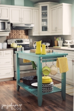 turqouise and yellow accents in a fresh white kitchen; love a table as a kitchen island!