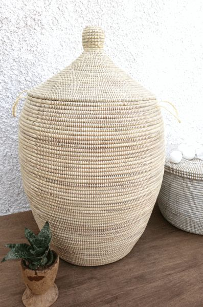 Extra Large Laundry hamper in plain ivory. This extra large basket can contain numbers of cloths in your bathroom or messy kids' toys and decorate your wooden floor or simply tiled or concrete space w