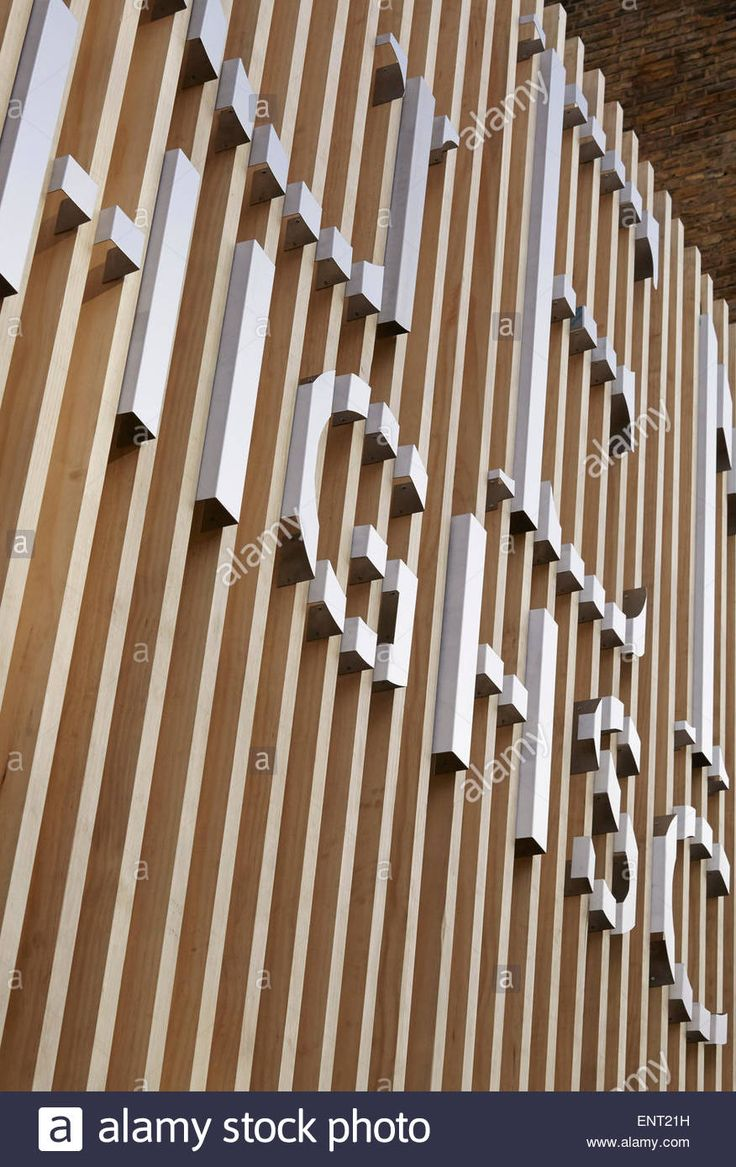 Detail of school's signage on timber fence. Regent High School, London, United Kingdom. Architect: Walters and Cohen Ltd, 2015
