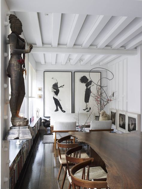 Figurative Sculptures in Contemporary dining room with wooden beams | modern residential interior design ideas