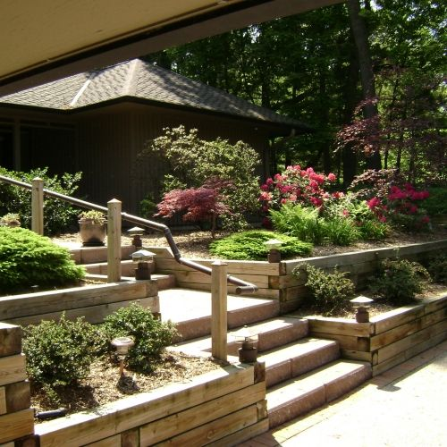 Modern style home in Ann Arbor with treated wood retaining wall