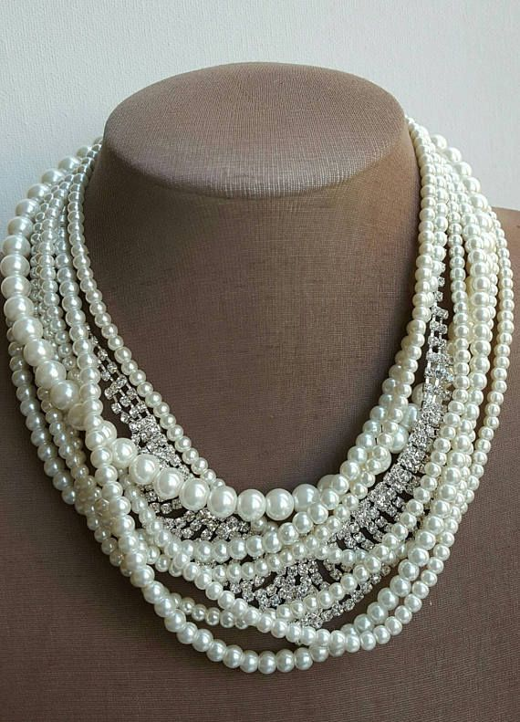 Check out this item in my Etsy shop https://www.etsy.com/ca/listing/511802388/multistrand-pearl-rhinestone-bridal