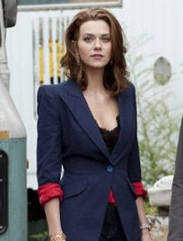 Sara Ellis from White Collar.  I want her wardrobe.  All of her outfits are smart -and- sexy.