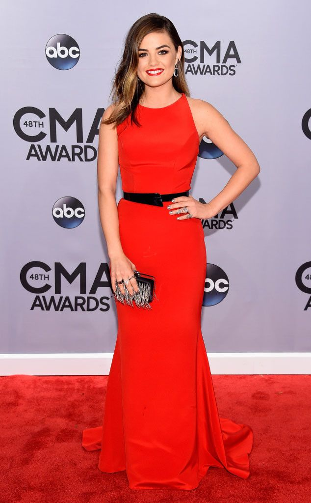 Lady in red! Lucy Hale's slim-fitting red Romona Keveza gown features a sexy, waist-cinching belt—love this red carpet look!