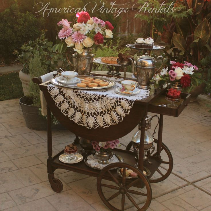 Our rolling Tea Cart set up for a Downton Abbey-Style afternoon tea. Complete with silver service, hand-crafted pedestal server and crocheted doilies for the aristocratic touch!