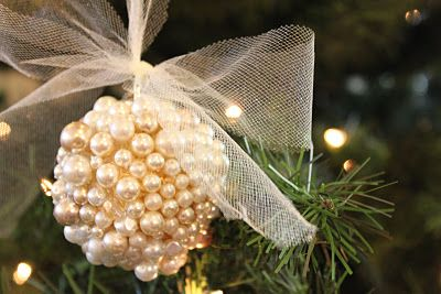 DIY: Pearl Ornament     Inexpensive bulbs from the dollar store  Many many pearls and other crystal beads if you desire  (I used pearls from a couple of broken necklaces that I had. Use about 70 pearls to cover one bulb.)  Hot glue gun  Tulle to string through the top