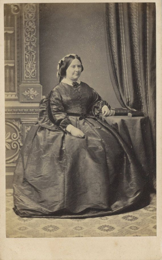 Wonderful condition CDV of a mature woman in a voluminous hooped gown, accented by a thin dark belt, white lace cap and large brooch. Image taken by London School of Photography. PayPal only. S/H is $3.25 which includes tracking, rigid photo mailer and rigid top loader or other rigid packing material.  International buyers welcome. Please convo (email me) for shipping quote to destination country before purchasing. Any customs charges, import fees, etc., for international buyers will be at…