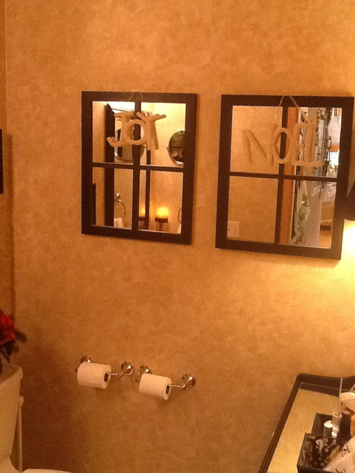 Mirrored faux windows add dimension to a small bath with for Small bathroom no natural light