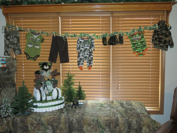 Clothes line display of camo baby clothes