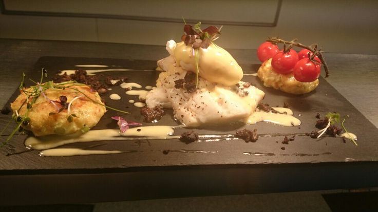 Baked haddock, poached egg, smoked haddock cakes, confit tomatoes, black pudding and lemon butter sauce.